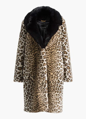 Faux Ocelot Fur Coat by St. John, available on stjohnknits.com for $1058 Gigi Hadid Outerwear SIMILAR PRODUCT