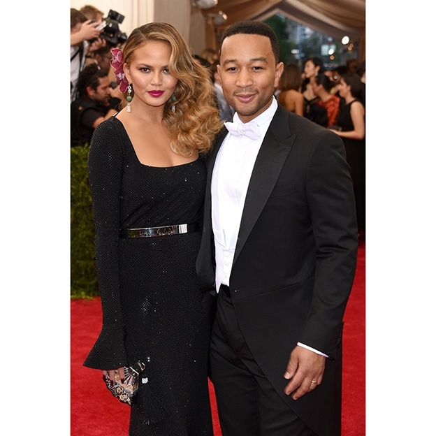 Chrissy Teigen wearing Saint John on the red carpet with John Legend