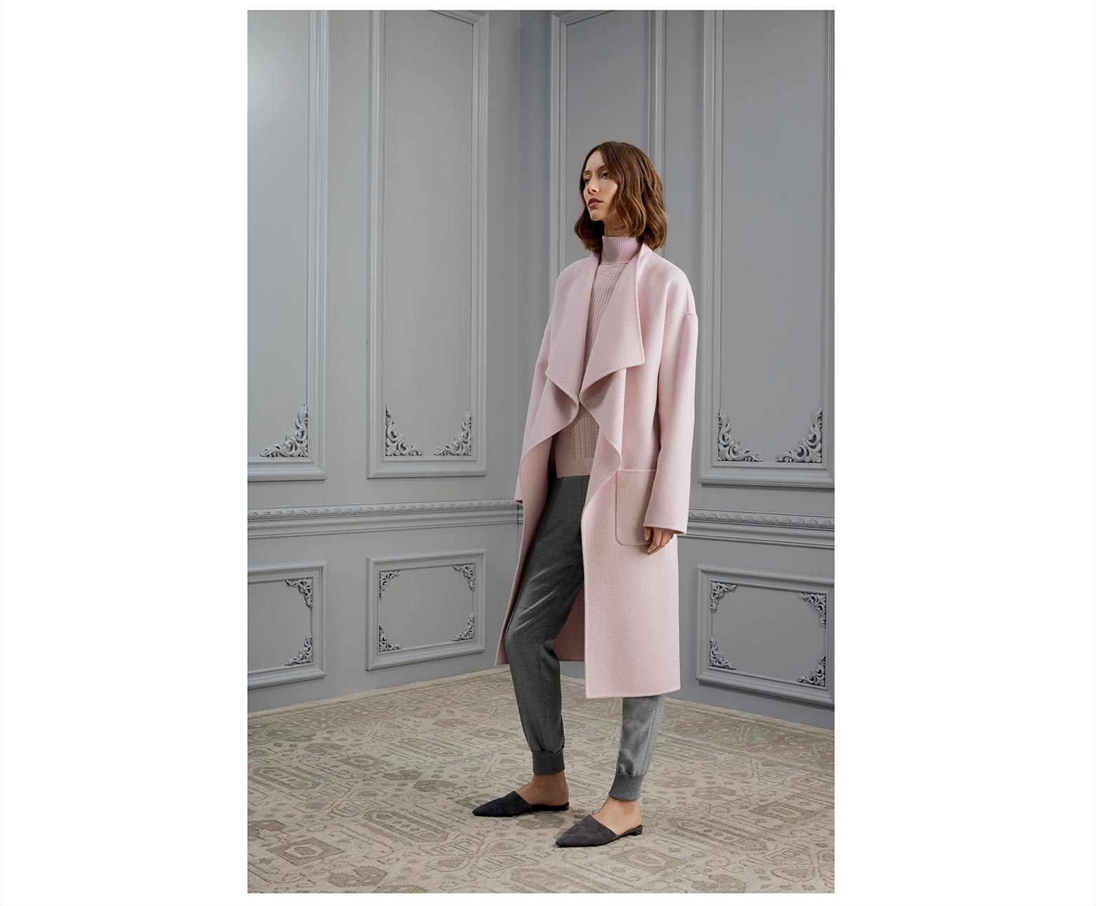 Model dressed in Saint John pink cashmere coat