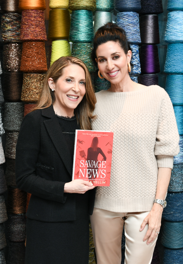 Jessica Yellin holding her book Savage News with Erin in Beverly Hills