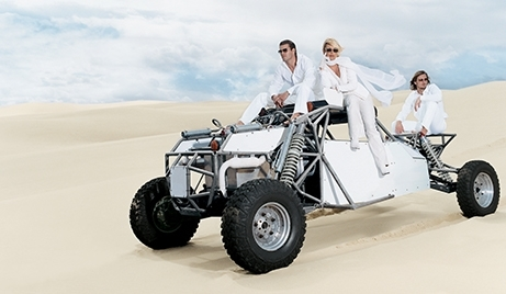 Kelly Gray in Saint John 2002 Spring Campaign wearing all white in sand dunes