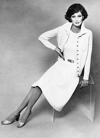 Model wearing Saint John knitted jacket, top, and skirt