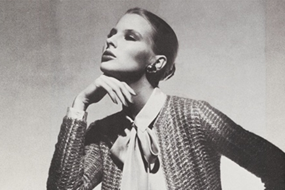 Model in Saint John knitted jacket and bow-tie neck blouse