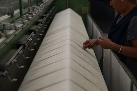Thread being inserted in knitting machine