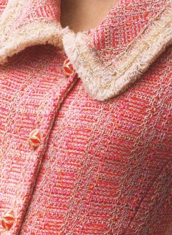 Close-up of pink knitted jacket